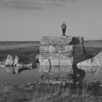 This is another photograph of the Little Manitou Lake Erratic. The rock is surrounded by a small pool of water and depending on what kind of year, can be shallow or relatively deep.