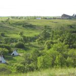 This is another photograph I took of Wanuskewin. I had set up some tipis on this small meadow that is called the Tipperary Creek Habitation Site and it's nestled deep in the valley. My personal involvement with Wanuskewin began in and around 1985 or so as I was asked by the Founding Elders and Meewasin Valley Authority to help out in different ways. This included helping out in the many ceremonies that they had on the site. In 1986, I was asked by the Elders and Meewasin Valley Authority to set up a tipi village including a stage and to coordinate a dance performance by Great Plains (our dance company) for the Royal Couple (Queen Elizabeth and Prince Phillip) who came to the site that Fall to designate it as a National Historic Site. Following this, I was again asked to co-choreograph/co-produce the Sound Track for the film on Wanuskewin and this also included doing a lot of Voice-Over work for the Main Gallery when it opened in 1992 where I was again asked to work on the Opening Ceremonies of the Park with our dance company Great Plains.