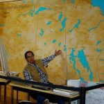 This is a photograph of me and a mapping project that I began about 20 years ago. I call it Nehiyaw Askiy Wasinahikan - Cree Land Map. My objective is to identify Cree Place Names ie. Sacred Sites, Rivers, Creeks, Lakes, Hills, etc. from the Rocky Mountains all the way to the Red River. A work-in-progress.