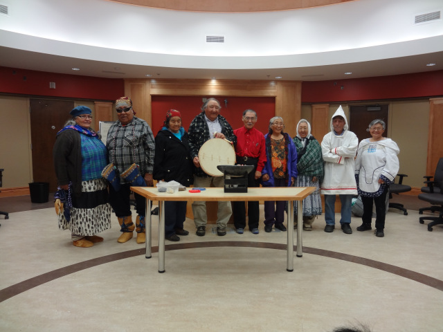 The gathering was opened with the lighting up the Qulliq at the Whapmagoostui Justice Building. Two Inuit Elders prepare to light up a traditional Inuit lamp. Afterwards, they asked a grandchild to bring the flame to a young Cree who, in turn, gave the flame to a Cree Elder, who then lit a fire inside a Cree teepee.