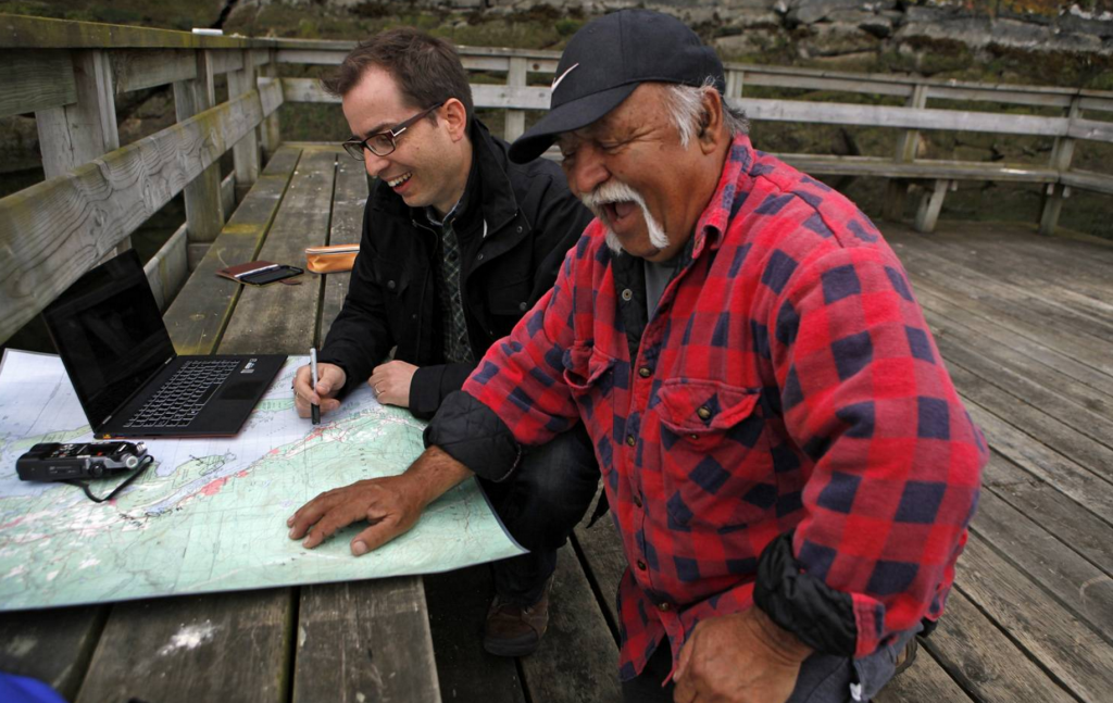 Dr. Brian Thom, UVic anthropologist and key indigenous leader with Google Earth Outreach, speaks with Stz'uminus First Nation elder Ray Harris near Ladysmith, B.C., on May 29, 2014, about how they can map their territories using Google Earth. (Chad Hipolito for The Globe and Mail)